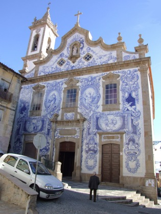 Azulejo-covered church front in Covilha
