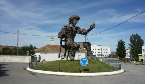 Statue of cobbler on roundabout in Aljustrel
