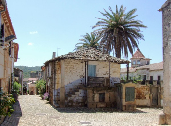 The historic village of Idanha-a-Velha. It's only April but already hot... the palm trees are a give away.