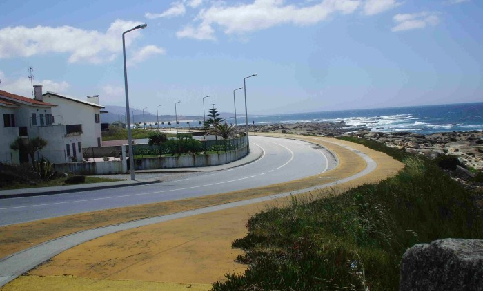 The yellow beachfront cycleway at Praia de Ancora in northern Portugal