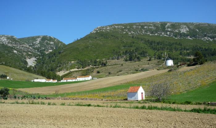 A windmill set against the hills of the Serrra de Montejunto