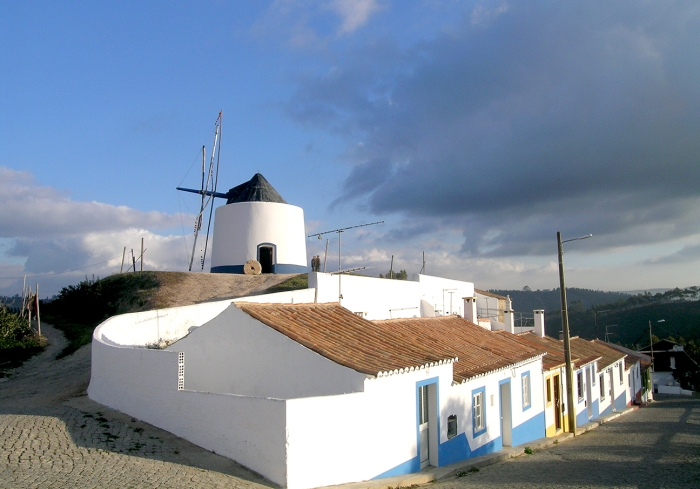 Traditional windmill and houses above the village of Odeceixe on the Algarve's west coast