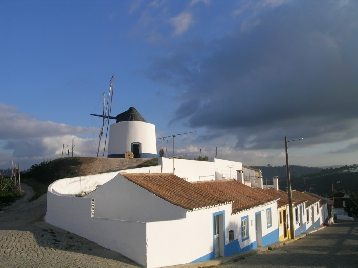 Old windmill above the pretty village of Odeceixe