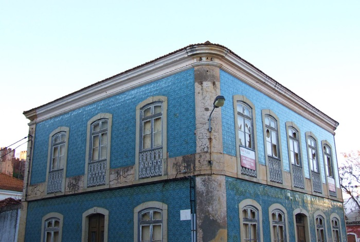 Typical old tiled building in Silves, set against the late afternoon sun